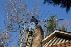 Performing chimney sweeping services